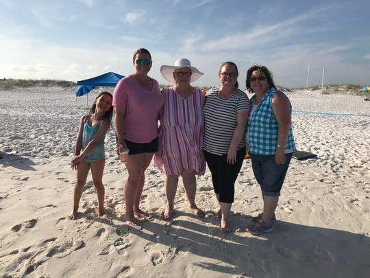 At center, Cheryl Cardwell, who was diagnosed with terminal cancer in October, was able to realize her dream of going to the beach thanks to Navarre Beach's Mobi Mats. She is pictured here with her granddaughter Ava Buchanan, far left; daughter Jordan Buchanan, second from left; daughter Jen Simpson, second from right; and sister Carol Melton, far right.