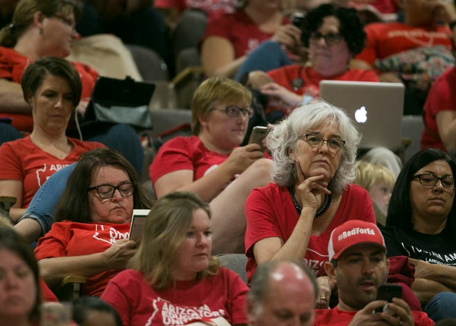 Supporters of the #RedforEd movement sit in the gallery in the Senate at the Arizona state Capitol in Phoenix on May 27, 2019.