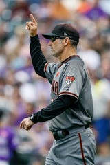 May 27, 2019: Arizona Diamondbacks manager Torey Lovullo (17) motions for a pitching change in the seventh inning against the Colorado Rockies at Coors Field.