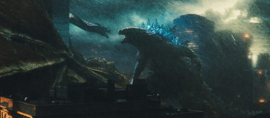 "King Ghidorah and Godzilla battle in ""Godzilla: King of the Monsters."""