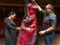 Colleen Jennings-Roggensack, executive director of ASU Gammage, meets Native American dress designer Loren Aragon at Gammage to try on the dress he designed for her to wear to the Tony Awards.