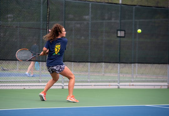 Port Huron Northern junior Isabella Murray swings for the ball during a scrimmage against St. Clair High School Tuesday, May 28, 2019, at Port Huron Northern High School. This weekend, the two teams will participate in the state tennis finals, beginning Friday.