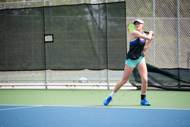 St. Clair High School senior Jillian Brooks watches the ball after a hit during a scrimmage against Port Huron Northern Tuesday, May 28, 2019, at Port Huron Northern High School. This weekend, the two teams will participate in the state tennis finals, beginning Friday.