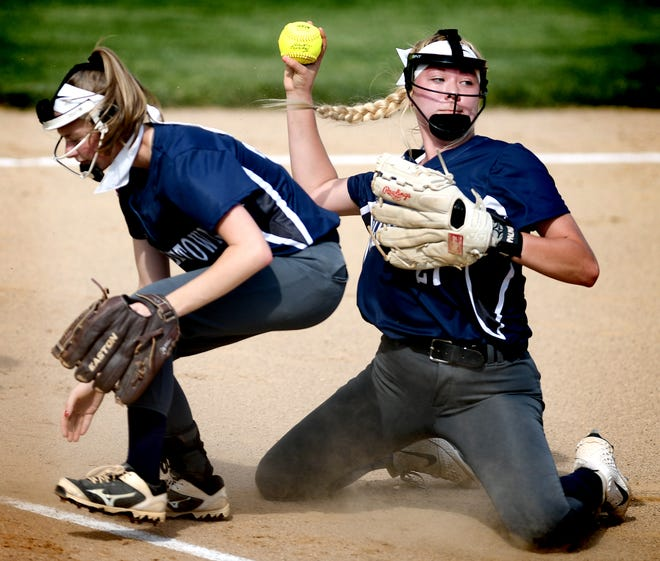 Dallastown pitcher Kelsie Merriman throws late to first as she and infielder Logan Opitz chase a bunt against Warwick during a District 3 Class 6-A softball semifinal at York College Tuesday, May 28, 2019. Warwick won 4-1. Bill Kalina photo