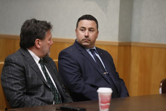 Rochester Police Office Michael Sippel was found guilty of third-degree assault.  Sippel looks at his attorney, Clark Zimmermann after the judge found him guilty.