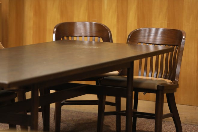 Defense table in a courtroom.