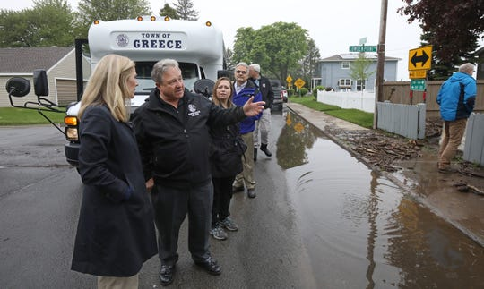 Greece Town Supervisor Bill Reilich shows the rising waters and crashing waves from Lake Ontario to Jane Corwin, US Section Chair for the International Join Commission, during a tour of flooding caused by Lake Ontario in Greece Tuesday, May 28, 2019 in Rochester.