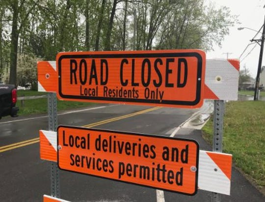 Edgemere Drive in Greece is closed due to flooding from Lake Ontario.