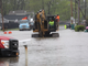 Heavy machinery is called in to install pumps in waist-deep water on Edgemere Drive in Greece on Tuesday, May 28, 2019.
