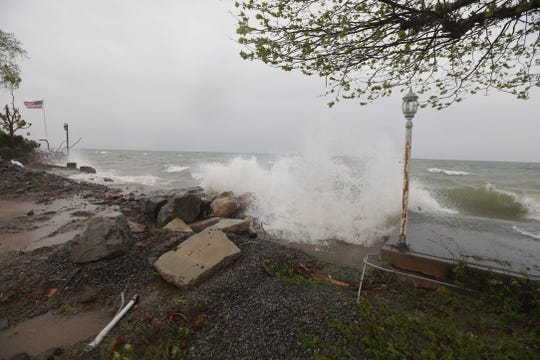 Wind whips waves from Lake Ontario against a wall near the former Crescent Beach Restaurant in Greece.