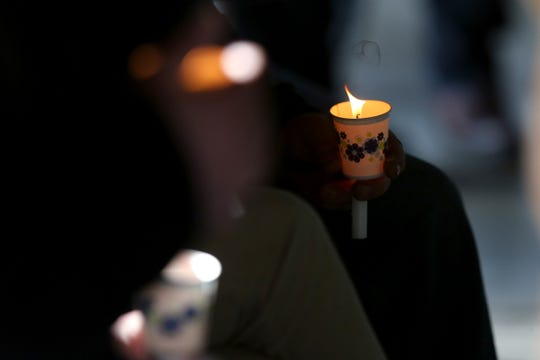 Cups are used to keep candles in place during a vigil held for a missing Salem mother and her son at Maud Williamson State Recreation Site in rural Yamhill County on May 27, 2019.