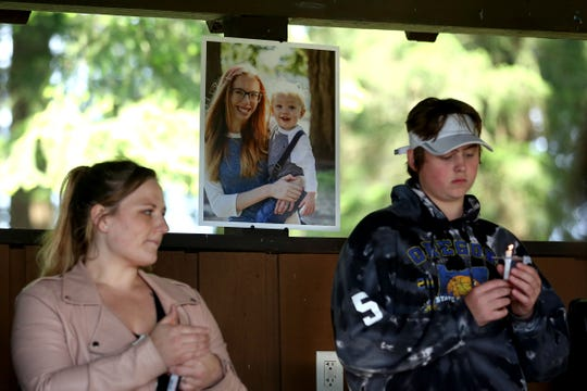 A photo of Karissa and William Fretwell is displayed during a candlelight vigil held for a Salem mother and son at Maud Williamson State Recreation Site in rural Yamhill County on May 27, 2019.