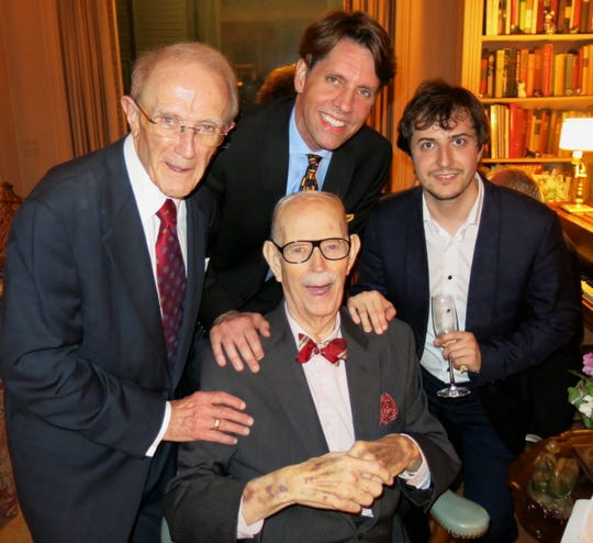 Delton Harrison is pictured with (clockwise, from seated), Dr. Jerry Martin, Michael Butterman and pianist Kenny Broberg.  Harrison hosted a party in his home to honor Broberg, who was on his way to Moscow to compete in the Tchaikovsky International Piano Competition.