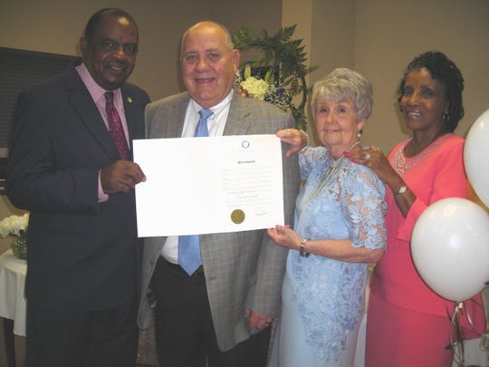 Shreveport City Council members and  close friends Willie Bradford and   James Flurry,   with Flurry's wife Pat and Bradford's wife Mary. They hold up a proclamation from Shreveport Mayor Adrian Perkins at the Flurrys' 50th Anniversary celebration.