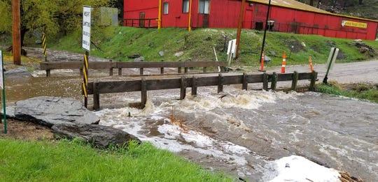 Creek water rushes over a bridge near Keystone.