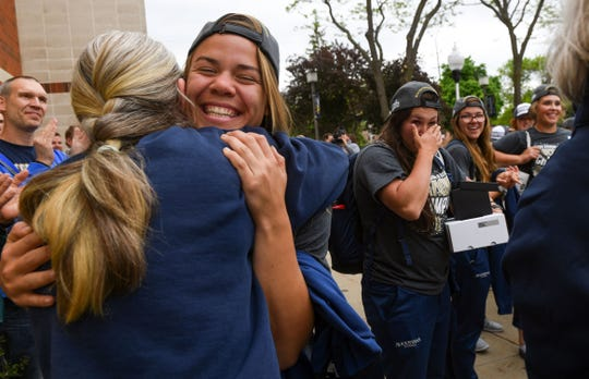 The Augustana University girls softball team greets their loved ones back home after winning the NCAA Division II national championship Tuesday, May 28, at the Elmen Center in Sioux Falls.