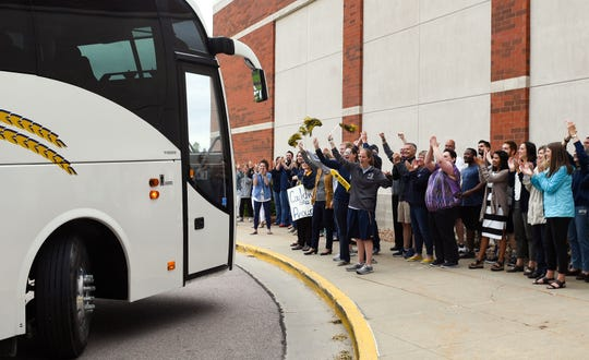 Augustana University girls softball fans greet the bus as it returns with the team after winning the NCAA Division II national championship Tuesday, May 28, at the Elmen Center in Sioux Falls.