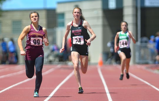 Krista Bickley of Brandon Valley catches up to Erin Kinney of Harrisburg during the 200 meter dash at the state high school track and field meet Saturday, May 25, at Howard Wood Field in Sioux Falls.