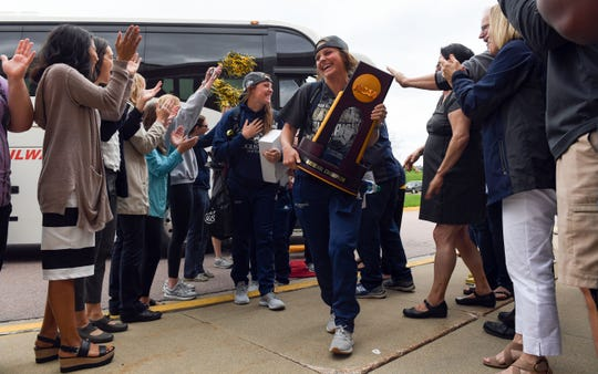 The Augustana University girls softball team returns with the NCAA Division II national championship trophy to a crowd of supporters Tuesday, May 28, at the Elmen Center in Sioux Falls.