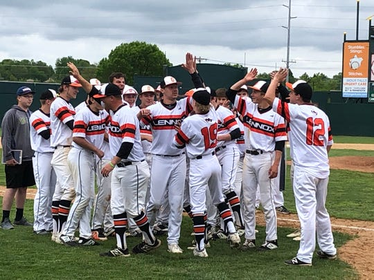 Lennox baseball celebrates after defeating Dakota Valley in the Class B championship game.