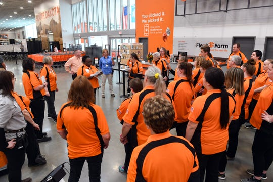 The employees of the new Fleet Farm in Sioux Falls get last-minute instruction before opening day Wednesday, May 29.