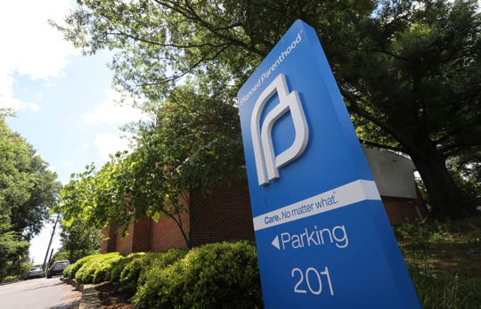 An AP file photo of a Planned Parenthood sign.