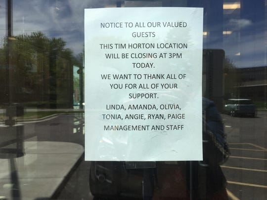 A sign outside the Tim Hortons location in St. Cloud announces its closure Tuesday, May 28.
