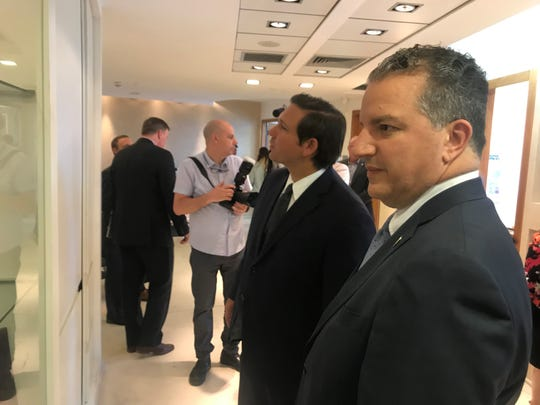 Gov. Ron DeSantis and CFO Jimmy Patronis examine a display at the Israel Space Agency in Tel Aviv.