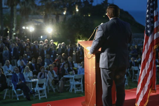 Gov. Ron DeSantis speaks to the Florida delegation gathered on the back lawn of  the U.S. Ambassador David Friedman's residence in Tel Aviv.