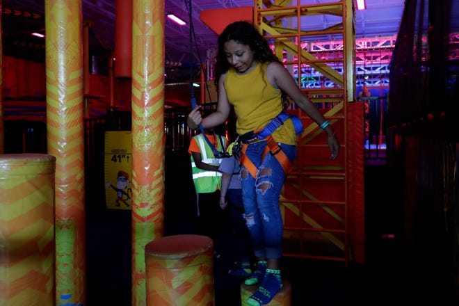 A seventh grade student from from W.R. Tolar K-8 School tries to keep her balance while climbing on an obstacle at Urban Air Tuesday, May 28, 2019.