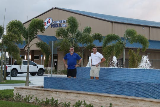 "2019 Lil Feet Jimmy Buffet Boot & Art Auction Sponsors A&G Concrete Pool owners Art Allen, left, and Travis Leonard dip their own ""little feet"" in the fountains in front of their new showroom facility at 8880 Glades Cut Off Road, Port St. Lucie."