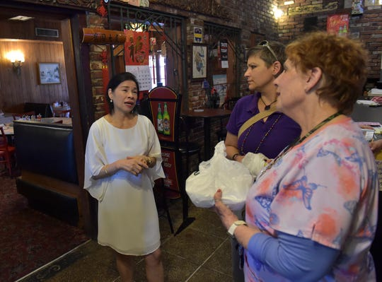 """Sue Liang (from left), co-owner of Szechuan Palace Chinese restaurant with her husband John, talks with her customers Michelle Walsh and Cathy Papitto on Tuesday, May 28, 2019, about  closing the restaurant to retire on June 15th. """"We eat here a lot, I just wish they weren't,"""" Papitto said about the restaurant closing. """"It's a great place to come at lunchtime, and it's always fast, and good, and they are very friendly and like to interact with their customers. It's a great place to come."""""""