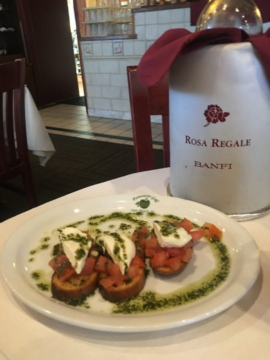 Enjoy the bruschetta at Pomodoro Grill with grilled slices of bread topped with sweet tomatoes, basil pesto, fresh mozzarella and lots of extra virgin olive oil.