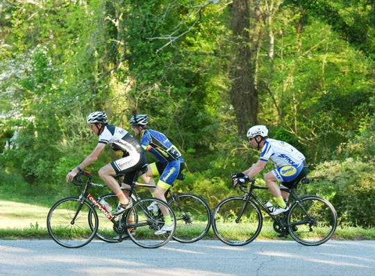 Cyclists with the Freewheelers Spartanburg ride through Duncan Park in Spartanburg on Wednesday, April 10, 2019.