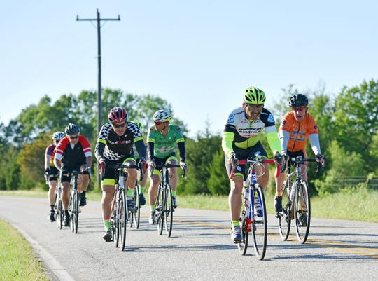 Cyclists with the Freewheelers Spartanburg group pedal down a country road near Moore, SC on Monday, April 15, 2019.