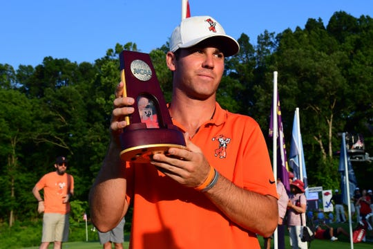 Oklahoma State sophomore Matt Wolff, a Westlake High graduate, holds up the trophy after winning the NCAA individual men's golf title Monday.