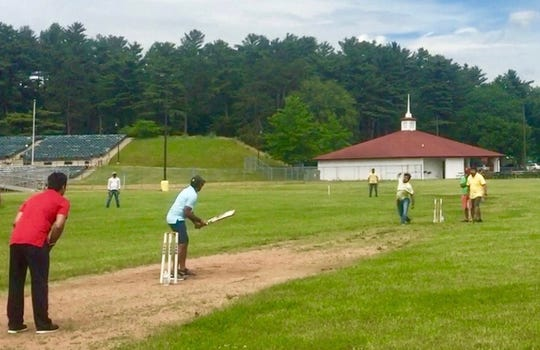 Playing cricket in Marathon Park. The Holi celebration will offer people a chance to take a crack at the game.