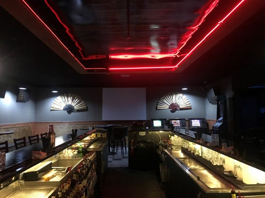 Night School, a new night club in Schofield, has a circular bar and old gaming machines.