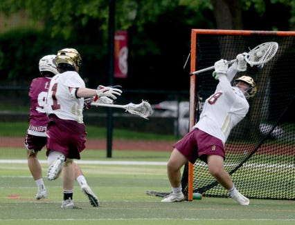 Ion Prep goalie Stephen Krug makes save during the New York State Catholic League lacrosse championship game against St. Joseph's at Iona Prep May 28, 2019. Iona Prep defeated St. Joseph 11-8.