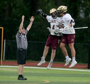 John Mitchell and Will Minihan of Iona Prep celebrate after Mitchell scored Iona Prep's final goal during the New York State Catholic League lacrosse championship game against St. Joseph's at Iona Prep May 28, 2019. Iona Prep defeated St. Joseph 11-8.