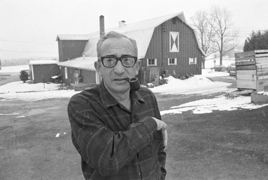 """Max Yasgur poses at his farm near Bethel, N.Y. on March 23, 1970.  Yasgur, who rented his farms for the Woodstock Music festival in 1969, received over 3,000 letters from young people who came to the weekend festival, some letters addressed to """"the groovy farmer at the festival.""""  His fields will be used for crops again this year.  (AP Photo)"""