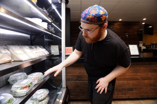 Mark Reznik, 22, of Wesley Hills organizes the refrigerator at Lillian's cafe, located at Rockland's Jewish Community Campus in West Nyack May 28, 2019. Lillian's cafe is a program designed by Rockland Jewish Family Service to help young adults on the autism spectrum, like Reznik, find meaningful employment.
