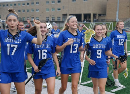 Bronxville's girls lacrosse team leave the field victorious over Millbrook in Tuesday's Class D regional semifinal in Newburgh on on May 28, 2019.