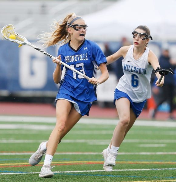 Bronxville's Kiki Tormey looks to clear the ball away from Millbrook's Caroline Malles during Tuesday's Class D regional semifinal in Newburgh on on May 28, 2019.