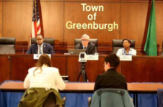 New York State Senators Zellmor Myrie, left, Brian Kavanagh, and Andrea Stewart Cousins listen to residents speak during a public hearing on rent regulation and tenant protection legislation at Greenburgh Town Hall May 28, 2019.