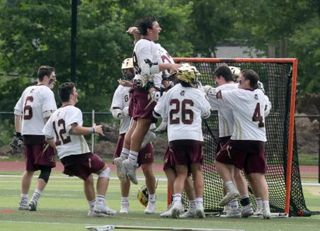 Iona Prep celebrates after defeating St. Joseph 11-8 in the New York State Catholic League lacrosse championship game against St. Joseph's at Iona Prep May 28, 2019.