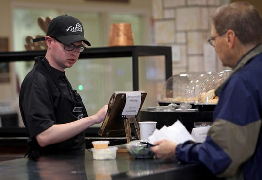 Scott Edelheit, 27, of New City, rings up a customer at Lillian's cafe, located at Rockland's Jewish Community Campus in West Nyack May 28, 2019. Lillian's cafe is a program designed by Rockland Jewish Family Service to help young adults on the autism spectrum, like Edelheit, find meaningful employment.