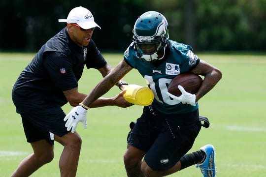 Eagles' DeSean Jackson, right, participates in a drill during organized team activities at the NFL football team's practice facility, Tuesday, May 21, 2019, in Philadelphia.