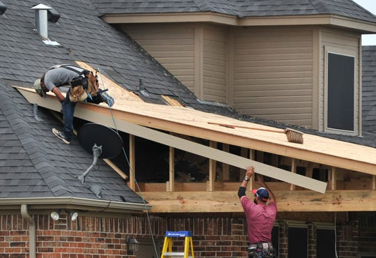 Construction work continues in some Wichita Falls neighborhoods, Tuesday.