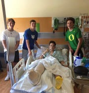 Windthorst's Tyler Etheredge surrounded by friends (from left) Ethan Belcher, Kyle Wolf and Gavin Steinberger at the hospital.